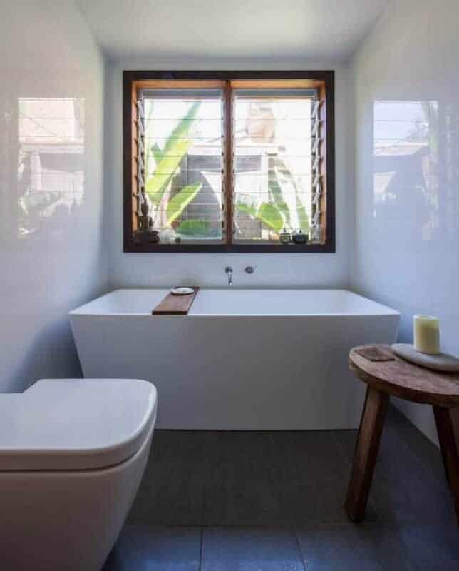 sustainable house cross ventilation louvre windows bathroom